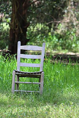 A Chair In The Grass Print by Lynn Jordan