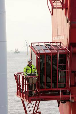 A Crane Operator On The Jack Up Barge Print by Ashley Cooper