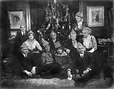 A Family With An Interesting Christmas Tradition Of Strange Hats Print by Underwood Archives