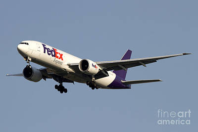 Airliners Photograph - A Federal Express Boeing 777f Cargo by Luca Nicolotti