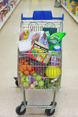 High Street Photograph - A Full Trolley Of Food by Ashley Cooper
