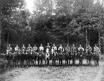 In A Row Photograph - A Group Of Fourteen Men On Horses Pose For A Group Portrait. by Underwood Archives