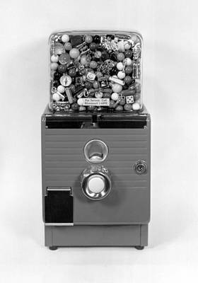 A Gumball Machine Print by Underwood Archives