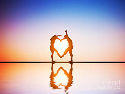 Sunlight Photograph - A Happy Couple In Love Making A Heart Shape With Their Bodies At Sunset by Michal Bednarek