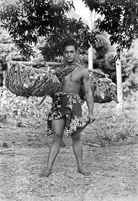 A Hawaiian With Coconuts Print by Underwood Archives