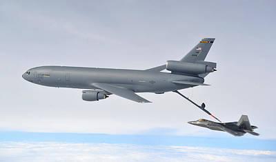 F-22 Photograph - A Kc-10 Extender Refuels An F-22 Raptor by Celestial Images