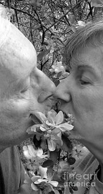 A Kiss Behind The Flowers Print by Renee Trenholm
