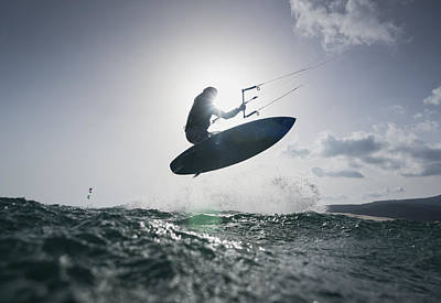 A Kitesurfer On His Board In Mid-air Print by Ben Welsh