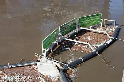 A Litter Trap On The Yarra River Print by Ashley Cooper