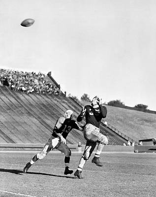 A Long Football Pass Print by Underwood Archives