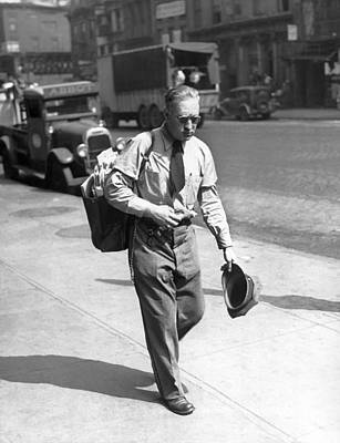 A  Mailman In The Heat Print by Underwood Archives