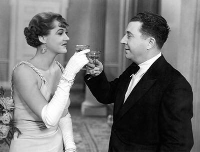 Alcoholic Beverages Photograph - A Man And A Woman Toast by Underwood Archives