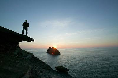 A Man On The Cliff Tops At Boscastle Print by Ashley Cooper