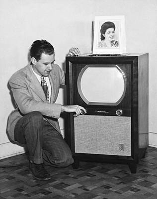 Crouched Photograph - A Man With His Tv by Underwood Archives