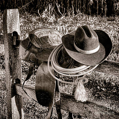 Wooden Fence Post Photograph - A New Workday For The Cowboy by Olivier Le Queinec
