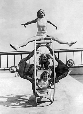Gymnast Photograph - A Rhoen Wheel Demonstration by Underwood Archives