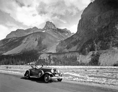Getting Away From It All Photograph - A Roadster In The Rockies by Underwood Archives