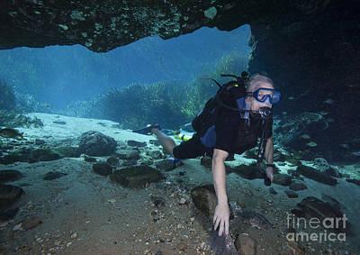 A Scuba Diver Explores The Blue Springs Print by Michael Wood