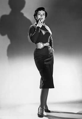 Cigarettes Photograph - A Seductive Woman by Underwood Archives