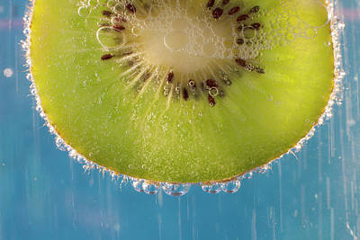 A Slice Of Kiwi Fruit In A Glass Print by Brian Jannsen