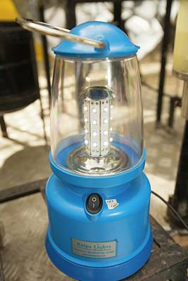 A Solar Lantern Powered By A Solar Panel Print by Ashley Cooper