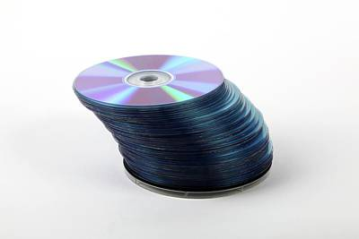 Large Group Of Objects Photograph - A Stack Of Recordable Discs by Photostock-israel
