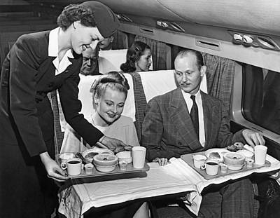 Airline Industry Photograph - A Stewardess Serving Breakfast by Underwood Archives