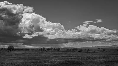 Prairie Storm Photograph - A Storm Rolls Into The Badlands by Thomas Young