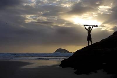 A Surfer On Muriwai Beach New Zealand Print by Deddeda