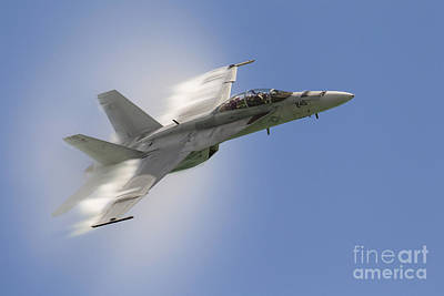 A U.s. Navy Fa-18f Performs A Fast Pass Print by Rob Edgcumbe