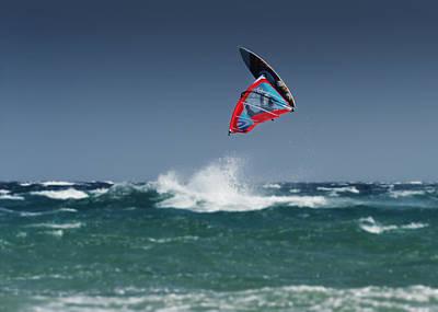 A Windsurfer Flips Upside Down Above Print by Ben Welsh