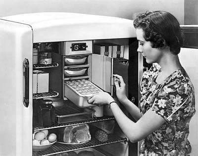 1945 Photograph - A Woman Making Ice Cubes by Underwood Archives