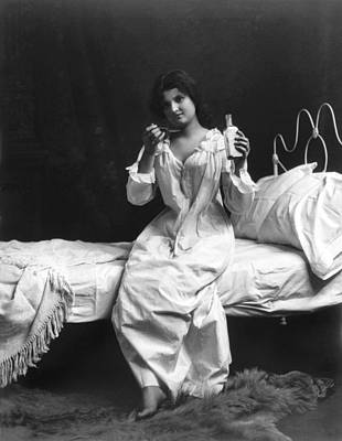 Healthcare-and-medicine Photograph - A Woman Taking Medicine by Underwood Archives