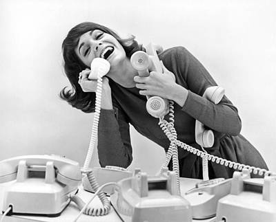 A Woman Tries To Answer Four Telephones Print by Underwood Archives