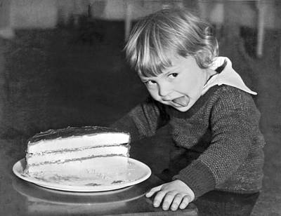 Bite Photograph - A Young Boy Ready For Cake by Underwood Archives