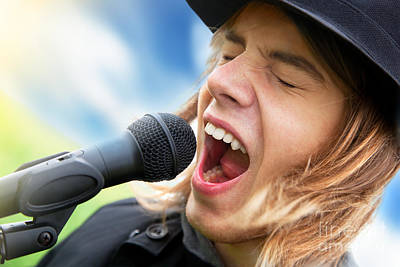 Singer Photograph - A Young Man Sings To A Microphone by Michal Bednarek