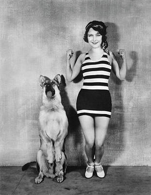 Actress And Dog Exercise Print by Underwood Archives