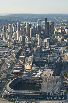 Seahawks Glass Photograph - Aerial View Of Seattle Skyline With The Pro Sports Stadiums by Jim Corwin