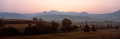 Romania Photograph - Agricultural Field With A Mountain by Panoramic Images