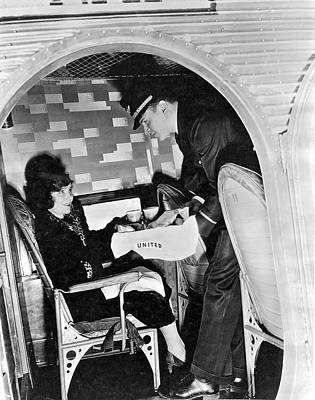 Airline Industry Photograph - Airline Steward Serves Woman by Underwood Archives