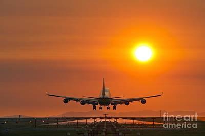 Passenger Plane Photograph - Airplane Landing At Sunset by David Nunuk