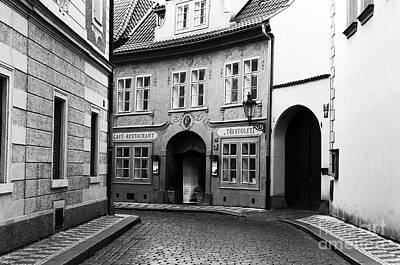 Prague Photograph - Alone In Prague by John Rizzuto