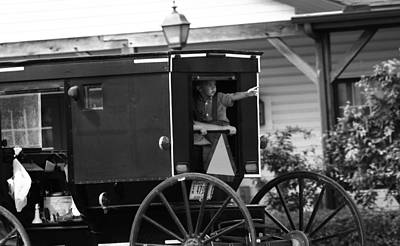 Amish Boy Waving In Horse And Buggy Print by Dan Sproul