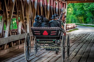 Amish Family On Covered Bridge Print by Gene Sherrill