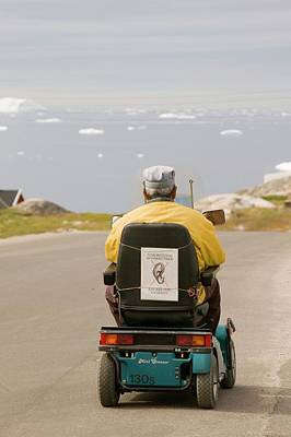An Inuit Man In A Mobility Scooter Print by Ashley Cooper