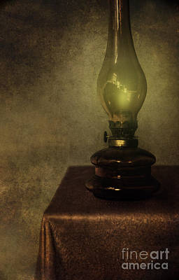 An Old Oil Lamp On The Table Print by Jaroslaw Blaminsky