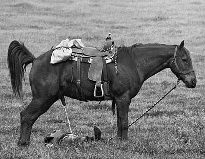 The Cowboy Photograph - An Unsuspecting Cowboy Grabs A Catnap On The Prairie While His H by Underwood Archives