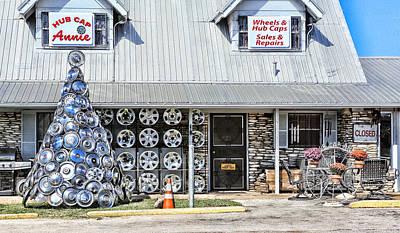 Annies Hub Cap Shop Print by Linda Phelps