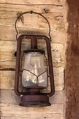 Log Cabin Photograph - Antique Lantern On Log Cabin Wall by Linda Phelps