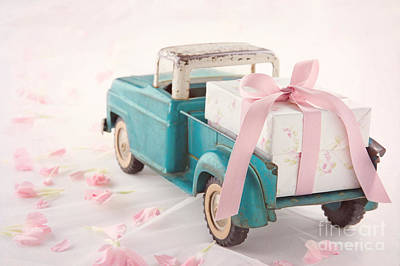 Antique Toy Truck Carrying A Gift Box With Pink Ribbon Print by Anna-Mari West